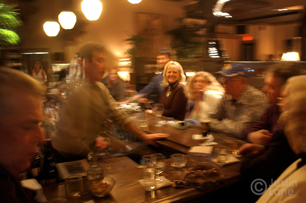 Patrons at Bentley's, a restaurant in Woodstock, VT, gather around the bar.<br /> JUSTIN LANE FOR THE NEW YORK TIMES