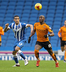 Connor Goldson of Brighton and Hove Albion and Benik Afobe of Wolverhampton Wanderers challenge for the ball - Mandatory byline: Paul Terry/JMP - 07966 386802 - 01/01/2016 - FOOTBALL - Falmer Stadium - Brighton, England - Brighton v Wolves - Sky Bet Championship