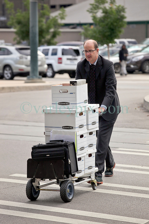 03 June  2015. New Orleans, Louisiana. <br /> Boxes of paperwork arrives at  Civil Distrcit Court for week 2 of a hearing to determine the competency of grandfather Tom Benson. Benson is the billionaire owner of the NFL New Orleans Saints, the NBA New Orleans Pelicans, various auto dealerships, banks, property assets and a slew of business interests. Rita, her brother and mother demanded a competency hearing after Benson changed his succession plans and decided to leave the bulk of his estate to third wife Gayle, sparking a controversial fight over control of the Benson business empire.<br /> Photo&copy;; Charlie Varley/varleypix.com