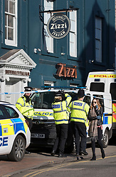 © Licensed to London News Pictures. 07/03/2018. Salisbury, UK. Police maintain a cordon around Zizzi Italian restaurant  where former Russian spy Sergei Skripal and his daughter Yulia Skripal visited before becoming ill with suspected poisoning. The couple where found unconscious on bench in Salisbury shopping centre. Specialist units have been called in to deal with any possible contamination. Photo credit: Peter Macdiarmid/LNP