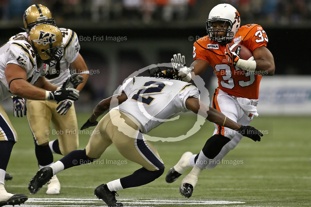 BC Lions' Running Back Joe Smith (no.33) // August 10, 2007 - BC Lions Vs Winnipeg Blue Bombers -- Canadian Football League -- 7:30pm -- BC Place Stadium, Vancouver, BC //.  .Bob Frid 2007.All Rights Reserved.778-834-2455 .bob.frid@freemotionphotography.ca.www.freemotionphotography.caAugust 10, 2007 - BC Lions Vs Winnipeg Blue Bombers -- Canadian Football League -- 7:30pm -- BC Place Stadium, Vancouver, BC // Winnipeg defeated the Lions 22-21  //.  .Bob Frid 2007.All Rights Reserved.778-834-2455 .bob.frid@freemotionphotography.ca.www.freemotionphotography.ca