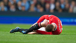MANCHESTER, ENGLAND - Monday, April 30, 2012: Manchester United's Wayne Rooney lies injured during the Premiership match against Manchester City at the City of Manchester Stadium. (Pic by Chris Brunskill/Propaganda)