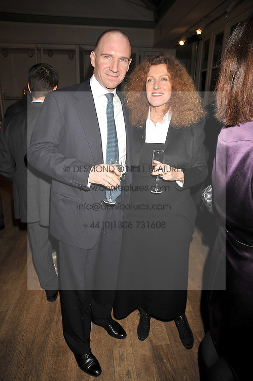 RALPH FIENNES and NICOLE FARHI at a dinner hosted by Nicole Farhi at 16 Fouberts Place, London W1 on 9th February 2009.