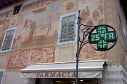 Frescoed building and dot matrix thermometer and other information in the modern city of Cortina d'Ampezzo, Veneto, Italy.