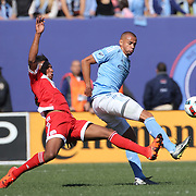 Tony Taylor, (right), NYCFC, is challenged by Juan Agudelo, New England Revolution, during the New York City FC Vs New England Revolution, MSL regular season football match at Yankee Stadium, The Bronx, New York,  USA. 26th March 2016. Photo Tim Clayton