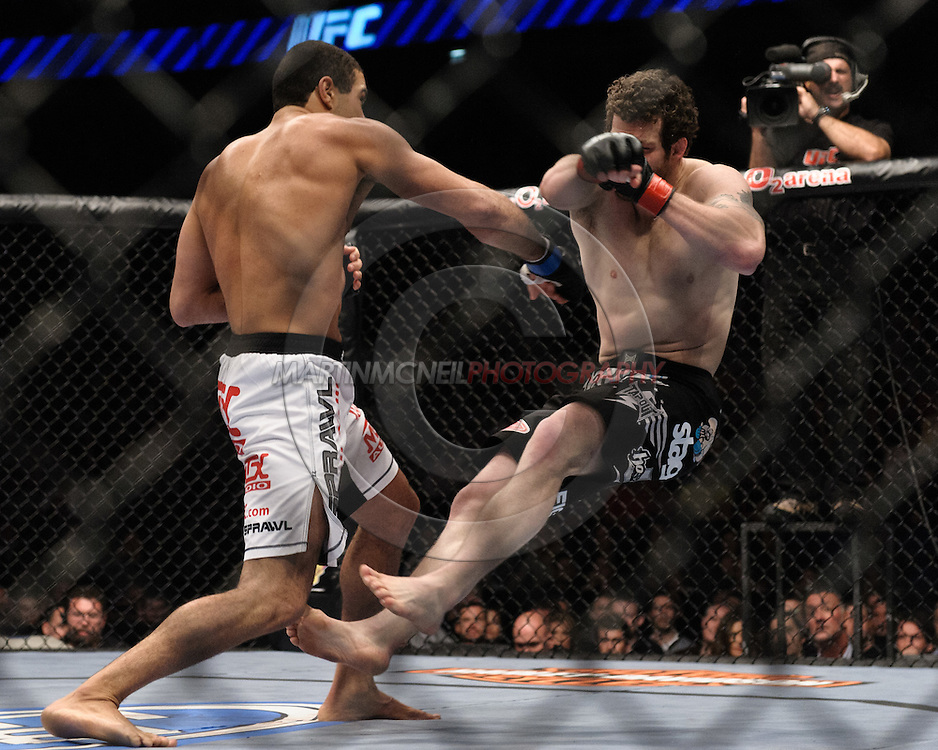 "LONDON, ENGLAND, JUNE 7, 2008: Thales Leites (left) knocks Nate Marquardt off his feet during ""UFC 85: Bedlam"" inside the O2 Arena in Greenwich, London on June 7, 2008."