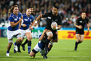 Victor Vito is tackled during the New Zealand All Blacks v Namibia Rugby World Cup 2015 match. The Stadium Queen Elizabeth Park in London, UK. Thursday 24 Septebmer 2015. Copyright Photo: Libby Law / www.Photosport.nz