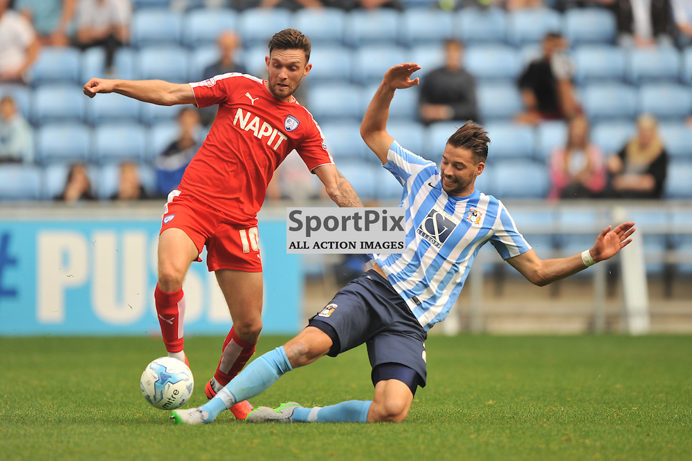 Coventrys Aaron Murphy slides in on Chesterfields Lee Novak, Coventry City v Chesterfield, Football League One, Ricoh Arena Coventry Saturday 19th September 2015