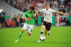 25.09.2013, Allianz Arena, Muenchen, GER, DFB Pokal, FC Bayern Muenchen vs Hannover 96, 2. Runde, im Bild Toni Kroos (FC Bayern Muenchen), rechts im Zweikampf, Aktion, mit Leonardo Bittencourt (Hannover96), quer,querformat,horizontal,landscape // during German DFB Pokal Match between FC Bayern Munich and Hannover 96 at the Allianz Arena, Munich, Germany on 2013/09/25. EXPA Pictures © 2013, PhotoCredit: EXPA/ Eibner/ Wolfgang Stuetzle<br /> <br /> ***** ATTENTION - OUT OF GER *****