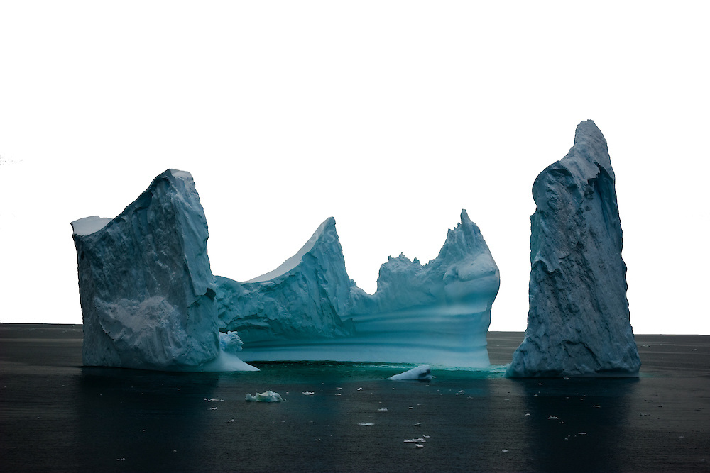 "This iceberg reminds of the painting by Bocklin called ""The Isle of the Dead"" - it's difficult to show scale with an image like this, but the iceberg was at least 100m tall in places, if not more. Photographed from on board the Greenpeace ship Esperanza, in the Southern Ocean, 8th February 2007. ...."