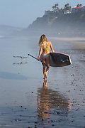 Teen Girl Walking on the Beach with Stand Up Paddle Board in San Clemente
