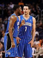 Dec. 09, 2012; Phoenix, AZ, USA; Orlando Magic guard J.J. Redick (7) and guard E'Twaun Moore (55) talk on the court during the game against the Phoenix Suns in the first half at US Airways Center. Mandatory Credit: Jennifer Stewart-USA TODAY Sports.