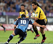 Hurricanes centre Ma'a Nonu on the charge during the Super 14 rugby union match between the Bulls and Hurricanes at Loftus Pretoria, South Africa, on Friday 17 March, 2006. The Hurricanes won the match 26-23. Photo: Africa Visuals/PHOTOSPORT **NZ USE ONLY**<br /> <br /> <br /> 149903