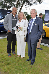 Left to right, DALEY THOMPSON and NICHOLAS & ANNIE COLQUHOUN-DENVERS at the Laureus King Power Cup polo match held at Ham Polo Club, Richmond on 16th June 2016.