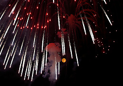 Fireworks explode in front of the supermoon outside the town of Mosta, celebrating the feast of its patron saint, in central Malta, August 10, 2014. The astronomical event occurs when the moon is closest to the Earth in its orbit, making it appear much larger and brighter than usual.<br /> REUTERS/Darrin Zammit Lupi (MALTA)