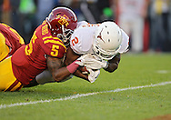 October 01, 2011: Texas Longhorns running back Fozzy Whittaker (2) is pulled down by Iowa State Cyclones defensive back Jeremy Reeves (5) on a 16 yard touchdown run during the first half of the game between the Iowa State Cyclones and the Texas Longhorns at Jack Trice Stadium in Ames, Iowa on Saturday, October 1, 2011. Texas defeated Iowa State 37-14.