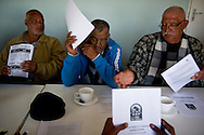 MANENBERG, SOUTH AFRICA - SEPTEMBER 12: Local NGO leaders and community organizers meet to discuss issues of gang violence, the activities of outreach programs and plan community gatherings at the Manenberg People Center building on September 12, 2013 in Manenberg, a township of Cape Town, South Africa. Participants in the meeting were unsettled by a recent gang shooting across the street from the center. Photo by Ann Hermes/The Christian Science Monitor