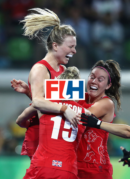 RIO DE JANEIRO, BRAZIL - AUGUST 19:  Hollie Webb of Great Britain (top) celebrates after scoring the winning penalty against the Netherlands during the Women's Gold Medal Match on Day 14 of the Rio 2016 Olympic Games at the Olympic Hockey Centre on August 19, 2016 in Rio de Janeiro, Brazil.  (Photo by David Rogers/Getty Images)