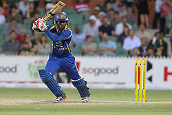 © Licensed to London News Pictures. 08/03/2012. Adelaide Oval, Australia. Upul Tharanga plays a cover drive during the One Day International cricket match final between Australia Vs Sri Lanka. Photo credit : Asanka Brendon Ratnayake/LNP