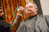 "The Rev. Dr. Matthew C. Harrison, president of The Lutheran Church–Missouri Synod, sits as the barber shaves his mustache at ""the Great Mustache Shave Off"" during the Liberty National LCMS Campus Ministry Conference on Wednesday, Jan. 4, 2017, at the University of Maryland in College Park, Md. LCMS Communications/Erik M. Lunsford"