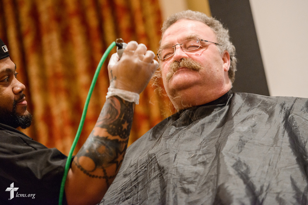 """The Rev. Dr. Matthew C. Harrison, president of The Lutheran Church–Missouri Synod, sits as the barber shaves his mustache at """"the Great Mustache Shave Off"""" during the Liberty National LCMS Campus Ministry Conference on Wednesday, Jan. 4, 2017, at the University of Maryland in College Park, Md. LCMS Communications/Erik M. Lunsford"""