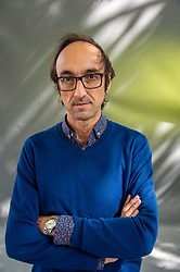 Pictured: Agustín Fernández Mallo<br /><br />Agustín Fernández Mallo is a physicist and Spanish writer. He lives in Palma de Mallorca. He is a member of the so-called Nocilla Generation. Although he works as a physicist, he also collaborates with cultural magazines such as Lateral, Contrastes, La Bolsa de Pipas, La fábrica and Anónima.<br /><br />Ger Harley | EEm 18 August 2019