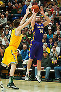 Great Danes forward Sam Rowley (14) takes a three point shot during the men's basketball game between the Albany Great Danes and the Vermont Catamounts at Patrick Gym on Wednesday night January 28, 2015 in Burlington, Vermont. (BRIAN JENKINS, for the Free Press)