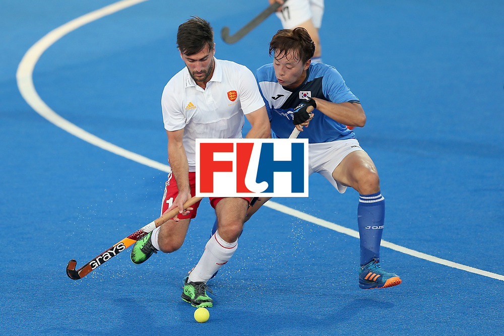 LONDON, ENGLAND - JUNE 20: Adam Dixon of England and Daeyeol Lee of South Korea battle for the ball during the Pool A match between England and South Korea on day six of the Hero Hockey World League Semi-Final at Lee Valley Hockey and Tennis Centre on June 20, 2017 in London, England.  (Photo by Alex Morton/Getty Images)