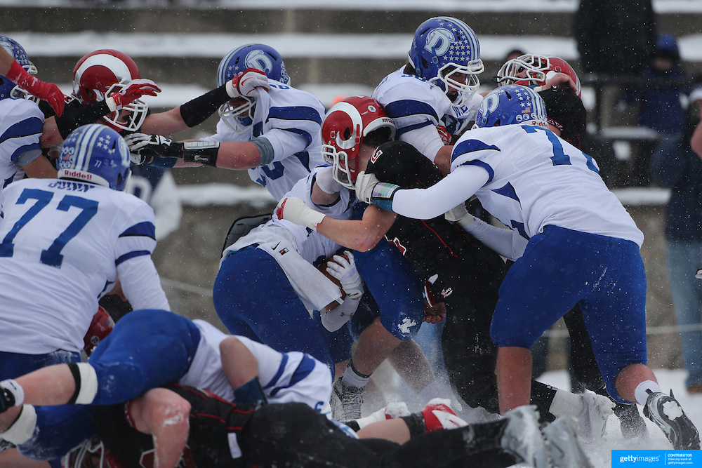 The New Canaan defense stop a Darien drive during the New Canaan Rams Vs Darien Blue Wave, CIAC Football Championship Class L Final at Boyle Stadium, Stamford. The New Canaan Rams won the match in snowy conditions 44-12. Stamford,  Connecticut, USA. 14th December 2013. Photo Tim Clayton