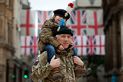 © Licensed to London News Pictures. 04/11/2012. London, UK. Major Chris Green, the Officer Commanding Vimy Company of the London Regiment, poses with his son Alfie Green (5) after a parade at Guildhall in London today (04/11/12).  The 52 reservists of Vimy Company, who come from all walks of life, paraded at Guildhall to be presented with their Operational Service Medals after returning from operations in Afghanistan.  Photo credit: Matt Cetti-Roberts/LNP