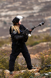 """23.10.2015, Ramallah, PSE, Gewalt zwischen Palästinensern und Israelis, im Bild Zusammenstösse zwischen Palästinensischen Demonstranten und Israelischen Sicherheitskräfte // A female Israeli border police fires tear gas towards Palestinian protesters during clashes near the Jewish settlement of Beit El, near Ramallah on October 23, 2015. Palestinian factions called for mass rallies against Israel in the occupied West Bank and East Jerusalem in a """"day of rage"""" on Friday, as world and regional powers pressed on with talks to try to end more than three weeks of bloodshed, Palestine on 2015/10/23. EXPA Pictures © 2015, PhotoCredit: EXPA/ APAimages/ Shadi Hatem<br /> <br /> *****ATTENTION - for AUT, GER, SUI, ITA, POL, CRO, SRB only*****"""