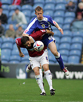 Photo: Paul Thomas.<br /> Burnley v Cardiff. Coca Cola Championship.<br /> 10/09/2005.<br /> <br /> Paul Parry out jumps Michael Duff.