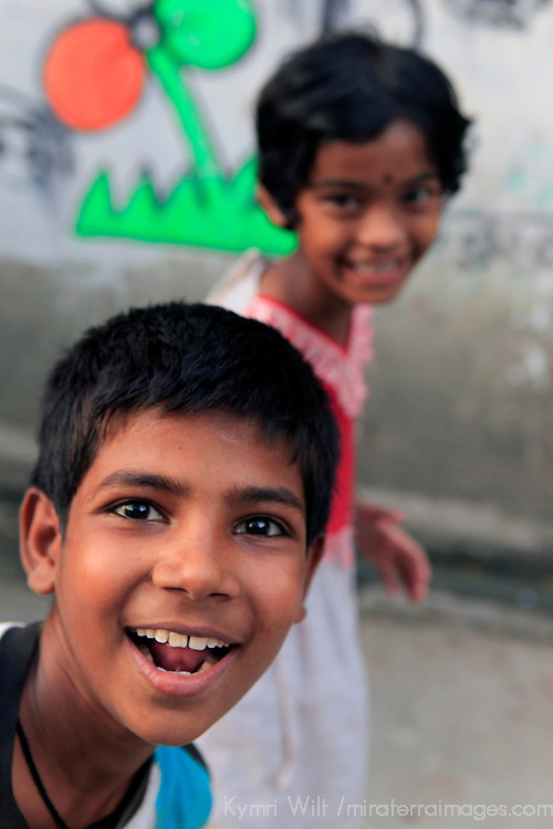 Asia, India, Calcutta. A young boy pops into frame while photographing a local Calcutta girl.