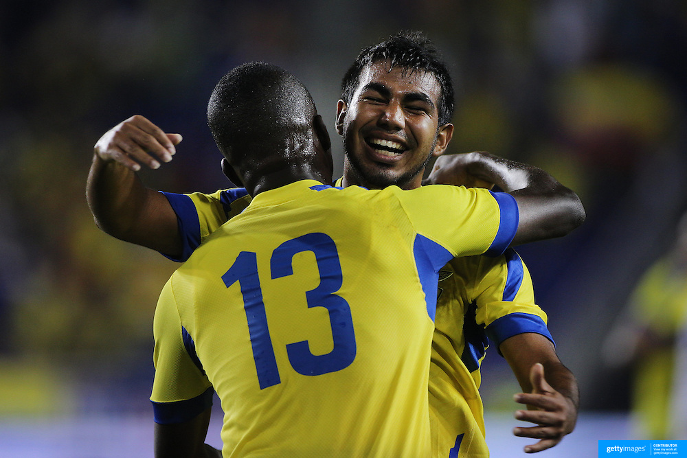 Enner Valencia, (left), Ecuador, is congratulated by teammate Junior Sornoza, after scoring during the Ecuador Vs El Salvador friendly international football match at Red Bull Arena, Harrison, New Jersey. USA. 14th October 2014. Photo Tim Clayton
