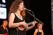 Cathy Guthrie playing a ukelele. She is, with Amy Nelson, Willie Nelson's daughter,  a member of Folk Uke.