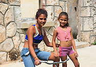Local girls in a derelict workers quarters in Hershey, Mayabeque, Cuba.