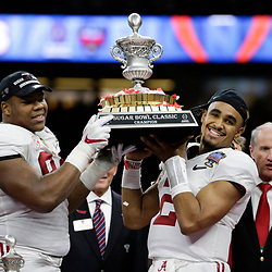 Jan 1, 2018; New Orleans, LA, USA; Alabama Crimson Tide defensive lineman Da'Ron Payne (94) and quarterback Jalen Hurts (2) hold up the game trophy after the game Clemson Tigers in the 2018 Sugar Bowl college football playoff semifinal game at Mercedes-Benz Superdome. Mandatory Credit: Derick E. Hingle-USA TODAY Sports