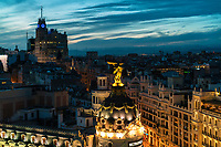 Skyline of the city of Madrid, Spain and the infamous Metropolis building in foreground at the sunset