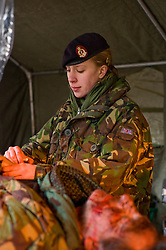 "4 Mechanized Brigade (4 Mech Bde) taking part in the Mission Specific Training on Salisbury Plain Training Area before deploying for the first time to Afghanistan where they will replacing 11 Light Brigade as the lead formation of British troops in Helmand province. -Combat Medical Technician  Pvt Natalie Jaques from Swinton of 3 Medical Regiment Daren ""Swifty"" Swift from the group ""Amputees In Action"" who provided real amputees. The addition of  stage makeup provides realistic casualties to help make the training as authentic,  as possible. . Helmand Province will be Natalies first Foreign  Posting since she joined the Army. (9  February 2010)"