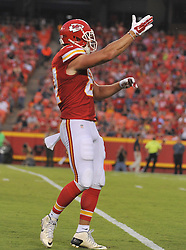 Aug 28, 2015; Kansas City, MO, USA; Kansas City Chiefs tight end Travis Kelce (87) does the tomahawk chop celebrating after a run during the first half against the Tennessee Titans at Arrowhead Stadium. The Chiefs won 34-10. Mandatory Credit: Denny Medley-USA TODAY Sports