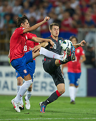 NOVI SAD, SERBIA - Tuesday, September 11, 2012: Wales' captain Aaron Ramsey in action against Serbia's Ljubomir Fejsa during the 2014 FIFA World Cup Brazil Qualifying Group A match at the Karadorde Stadium. (Pic by David Rawcliffe/Propaganda)