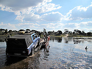 Africa, Botswana, 4x4 vehicle being driven on to the water ferry to cross the Boteti river.<br /> <br /> Picture by Zute Lightfoot