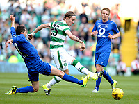 15/07/15 UEFA CHAMPIONS LEAGUE QUALIFIER<br /> CELTIC V STJARNAN<br /> CELTIC PARK - GLASGOW<br /> Celtic star Stefan Johansen (right) is challenged from Alti Johannsson.