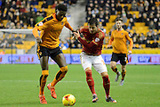 Nottingham Forest defender Daniel Pinillos and Wolverhampton Wanderers defender Dominic Iorfa battle during the Sky Bet Championship match between Wolverhampton Wanderers and Nottingham Forest at Molineux, Wolverhampton, England on 11 December 2015. Photo by Alan Franklin.