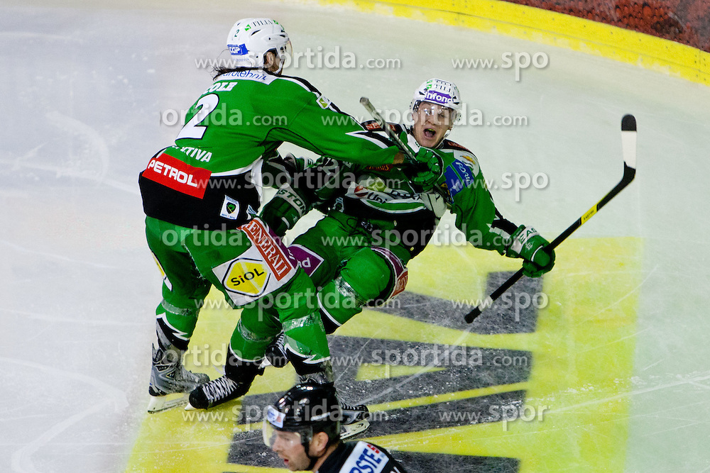 John Hughes (HDD Tilia Olimpija, #72) celebrates his game-winning goal with Brad Cole (HDD Tilia Olimpija, #2) during ice-hockey match between HDD Tilia Olimpija and SAPA Fehervar AV19 at second match in Quarterfinal  of EBEL league, on Februar 21, 2012 at Hala Tivoli, Ljubljana, Slovenia. HDD Tilia Olimpija won 2:1 in OT. (Photo By Matic Klansek Velej / Sportida)