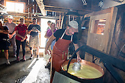 Don't miss Eigeralp farm's traditional breakfast (or a longer farm stay), at Bussalp, above Grindelwald, in the canton of Bern, Switzerland, the Alps, Europe. Every day, immediately in front of you, Eigeralp farm produces a variety of artisan cheeses and Alpine butter from raw milk in a large cauldron over an open fire. For breakfast, enjoy fresh bread from the oven, Alpine butter, various cheeses, yogurt, homemade jams, coffee, tea and fresh milk! While Eigeralp's huts were built in 1892, its traditional cheese hut dates from the 1600s. While grazing, gaze out over the peaks of the Eiger, Mönch, and Jungfrau in these astoundingly spectacular high meadows. The farm, on the internet at www.Eigeralp.ch, can be reached as follows: ride the private GrindelwaldBus.ch to the last stop in Bussalp, then ascend 40 minutes on foot. The Swiss Alps Jungfrau-Aletsch region is honored as a UNESCO World Heritage Site. For licensing options, please inquire.
