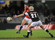 Ronan O'Gara of the Lions kicks ahead with Guy Cronje of the Sharks to late to block his kick.<br /> Rugby - 090610 - British&Irish Lions v Sharks - ABSA Stadium - Durban - South Africa. The Lions won 37 -3.<br /> Photographer : Anton de Villiers / SASPA