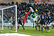 Scott Fox (#1) of Ross County punches the ball clear form a corner during the Ladbrokes Scottish Premiership match between Hibernian and Ross County at Easter Road, Edinburgh, Scotland on 23 December 2017. Photo by Craig Doyle.