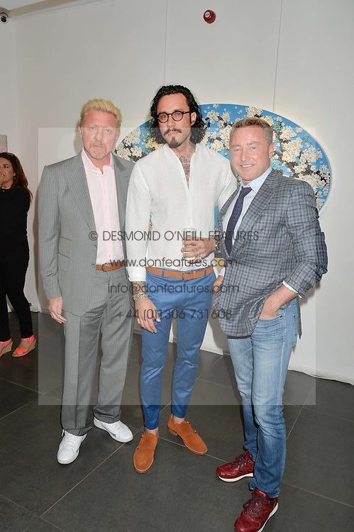 Left to right, BORIS BECKER, artist MIKE DARGAS and MICHAEL FLATLEY at a private view of woks by German artist Mike Dargas held at the Opera Gallery, 134 New Bond Street, London on 5th July 2016.