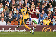 Arsenal midfielder Santi Carzola (19)  and Burnley defender Ben Mee (6) challenge for the ball during the Premier League match between Burnley and Arsenal at Turf Moor, Burnley, England on 2 October 2016. Photo by Simon Davies.